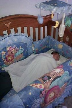 Baby crib with bedding.